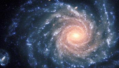 "This spectacular image of the large spiral galaxy NGC 1232 was obtained on September 21, 1998, during a period of good observing conditions. It is based on three exposures in ultra-violet, blue and red light, respectively. The colours of the different regions are well visible : the central areas contain older stars of reddish colour, while the spiral arms are populated by young, blue stars and many star-forming regions. Note the distorted companion galaxy on the left side, shaped like the greek letter ""theta"". NGC 1232 is located 20º south of the celestial equator, in the constellation Eridanus (The River). The distance is about 100 million light-years, but the excellent optical quality of the VLT and FORS allows us to see an incredible wealth of details. At the indicated distance, the edge of the field shown corresponds to about 200,000 light-years, or about twice the size of the Milky Way galaxy. The image is a composite of three images taken behind three different filters: U (360 nm; 10 min), B (420 nm; 6 min) and R (600 nm; 2:30 min) during a period of 0.7 arcsec seeing. The field shown measures 6.8 x 6.8 arcmin. North is up; East is to the left. #L"